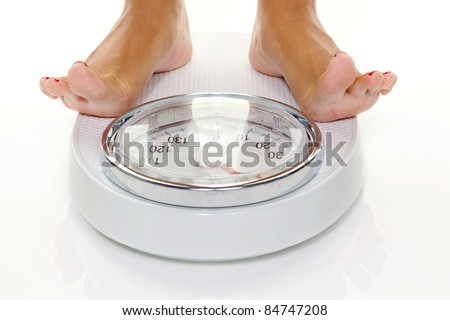 the feet of a woman standing on scales
