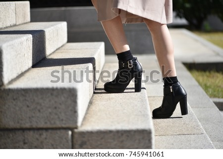 The feet of a woman walking up the stairs #745941061