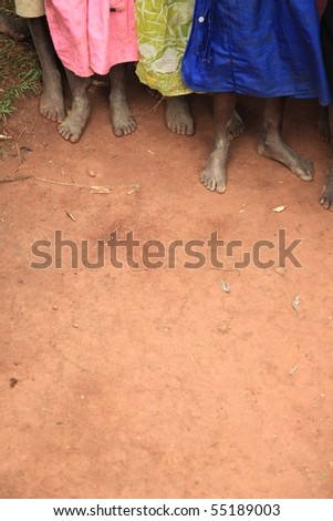 The Feet of Children Living in Poverty in Uganda, Africa - stock photo