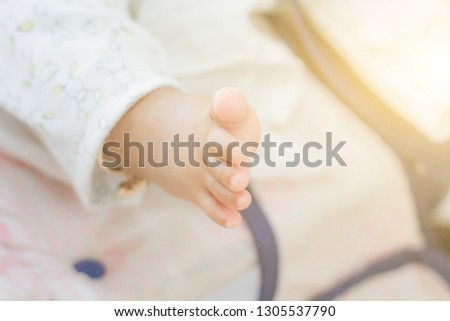 The feet of infants or baby sleeping on the bed , soft focus , blurred.
