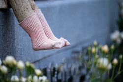 The feet of the statues that exist inside the rose garden