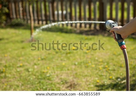 The female hand holds the irrigation shower #663855589