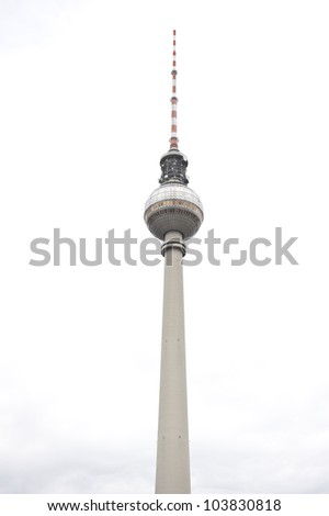 The Fernsehturm television tower in a cloudy, white sky.