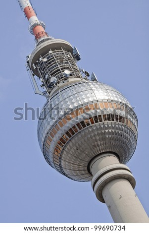 The Fernsehturm Television tower in Alexanderplatz central of Berlin (Germany), with sky in background, oblique composition.