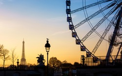 The ferris wheel and the Eiffel Tower in Paris, France