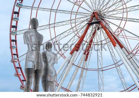 Shutterstock The Ferris wheel and the statue of Ali and Nino on the embankment of Batumi. Georgia, Batumi
