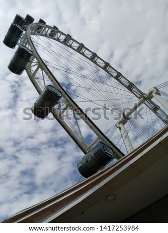 The ferris wheel goes round and round