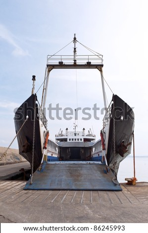 The ferry at the port with an open gate