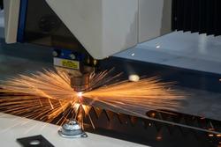 The fiber laser cutting machine cutting the sheet metal  plate. The hi-technology sheet metal manufacturing process by laser cutting machine.