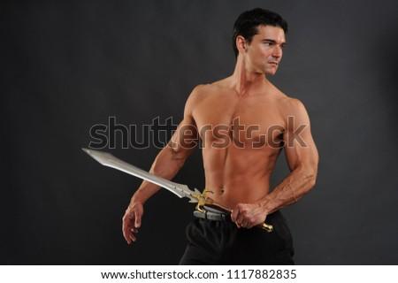 The fierce warrior holds a sword.