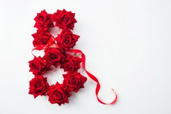 The figure eight of beautiful scarlet roses isolated on a white background. Greeting card for Women's Day on March 8. Copy space for text. March 8 and the concept of