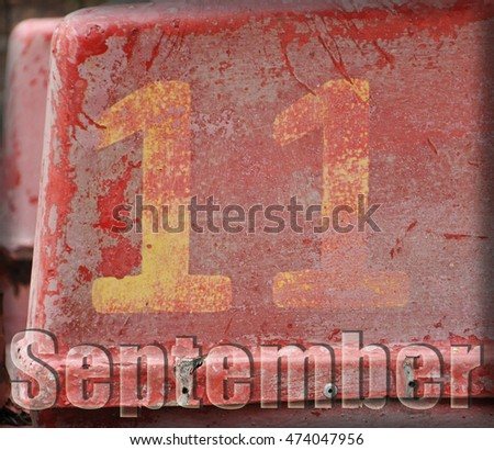 "the figure eleven on a red shabby background. the inscription ""September"" #474047956"