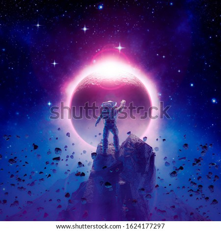 The final eclipse / 3D illustration of science fiction scene showing astronaut viewing solar eclipse from mountain surrounded by asteroids in space Foto stock ©