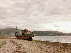 The final resting place of the ship on the banks of corpach over looking to fort William and Ben nevis