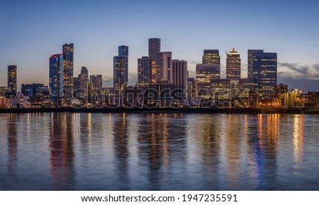 The financial district of London, Canary Wharf, with the illuminated, cooperate skysrcapers during evening time Stockfoto ©
