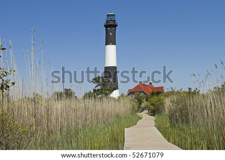 The Fire Island Lighthouse as seen from the nature boardwalk in Fire Island National Seashore State Park in Long Island.