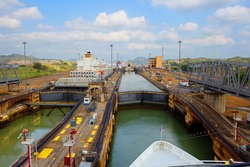 The first lock of the Panama canal from the Pacific ocean. The gateway is located within the modern state of Panama. The photograph shows grey design of a movable bridge.