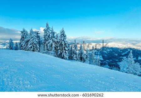 The first shadows of setting sun on winter mountain slopes with ski run (Skole Beskids, Lviv Oblast, Carpathians, Ukraine) - Shutterstock ID 601690262