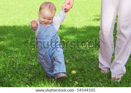 The first steps of the kid - stock photo