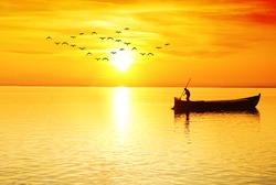 the fisherman in the sea at sunrise