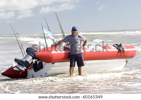 The fisherman posing next to his boat