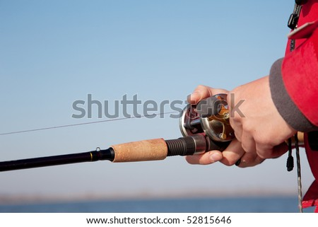 The fisherman with a baitcasting reel