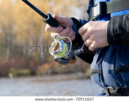 The fisherman with a fishing reel
