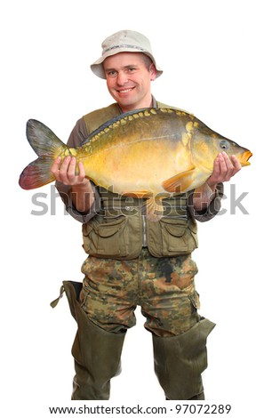 The fisherman with big fish (Common Carp - Cyprinus Carpio). Success concept.