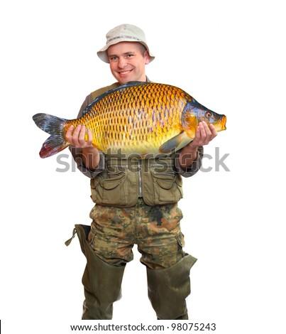 The fisherman with big fish (Common Carp - Cyprinus Carpio). Success concept.