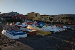 The fishing boats park on the beach of  Lake Bracciano,Italy.Period winter in the afternoon.