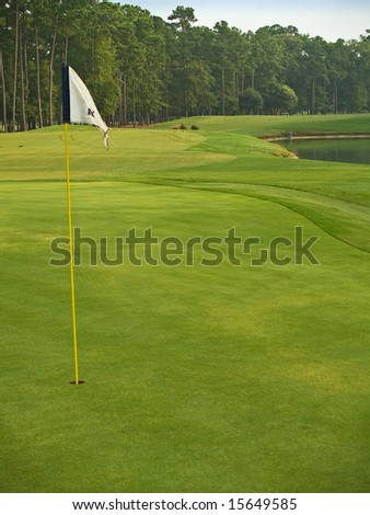 The flag and lots of beautiful green grass on this Myrtle Beach, South Carolina golf course.