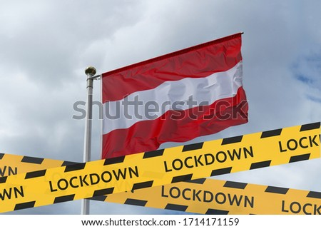 The flag of Austria against the sky and a protective tape with the inscription lockdown. Concept - Austria is quarantined due to the coronavirus epidemic.