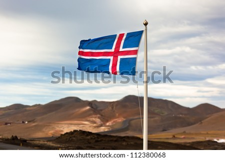 The flag of Iceland waving in the wind on a background of a stormy sky