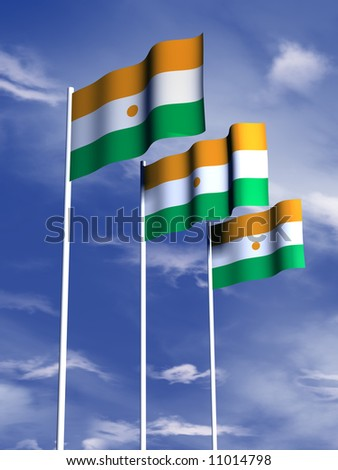 The flag of Niger flies in front of a blue sky