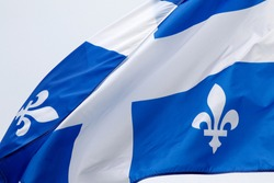 The flag of Quebec in the wind