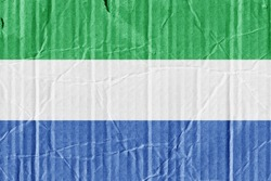 The flag of Sierra Leone painted on a cardboard box