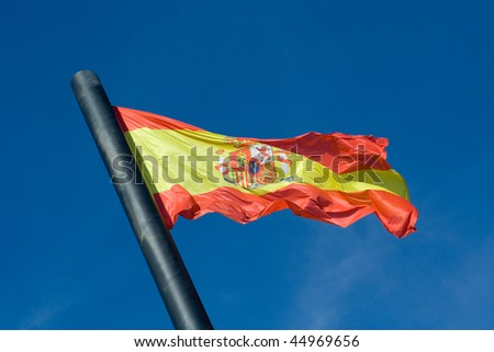The Flag of Spain with Blue Sky