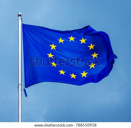 The flag of the European Union , against the background of the sunny sky. State symbols, politics. #788550958