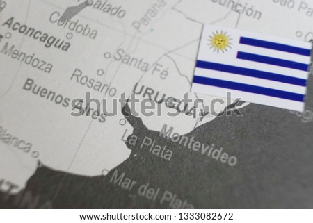 The flag of Uruguay placed on Uruguay map of world map #1333082672