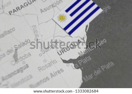The flag of Uruguay placed on Uruguay map of world map #1333082684