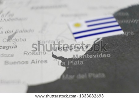 The flag of Uruguay placed on Uruguay map of world map #1333082693