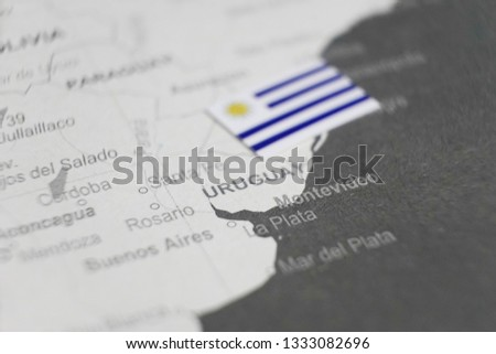 The flag of Uruguay placed on Uruguay map of world map #1333082696