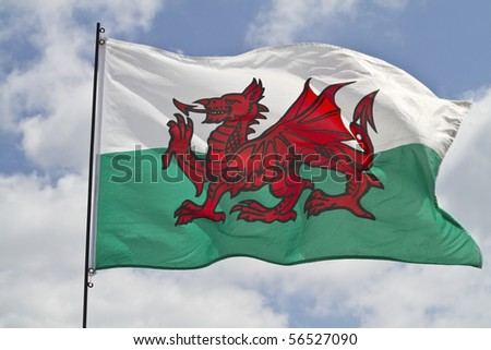 The flag of Wales flying in sunshine - stock photo