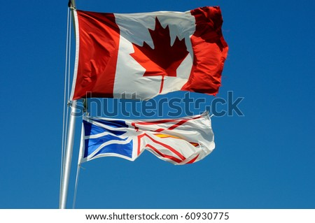 The Flags Of Canada And Newfoundland And Labrador Flying From A Flagpole