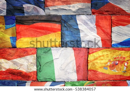 The flags of EU countries drawn on a brick wall
