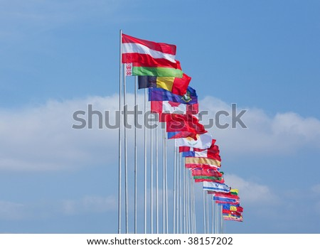 The flags of some countries on background blue sky - stock photo