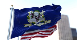 The flags of the Connecticut state and United States of America waving in the wind. Democracy and independence. American state.