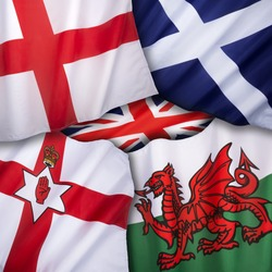 The flags of the United Kingdom of Great Britain - England, Scotland, Wales and Northern Ireland.