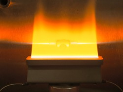 The flame of the flame atomic absorption spectrophotometer.