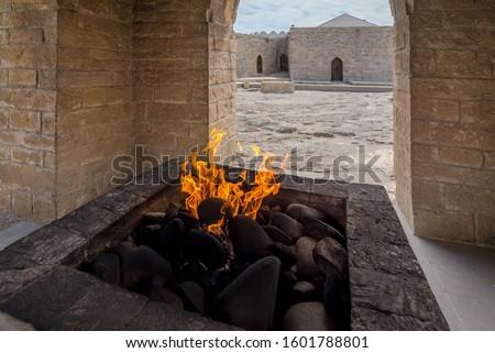 The flame on the altar in the Ateshgah of Baku - The Fire Temple of Baku, located in the town Surakhani on Absheron Peninsula, near Baku, Azerbaijan